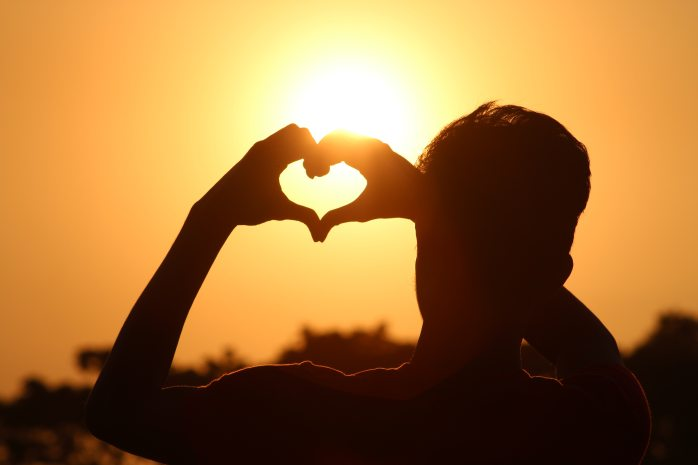 silhouette-photo-of-man-doing-heart-sign-during-golden-hour-712520